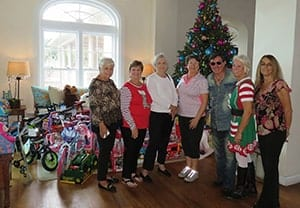 Orchid Island Members in front of tree at Christmas Time