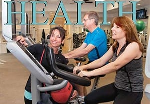 People on cardio equipment at Orchid Island Health Club