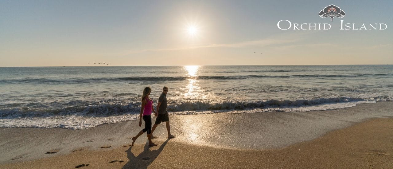 Couple walking on beach in Vero Beach